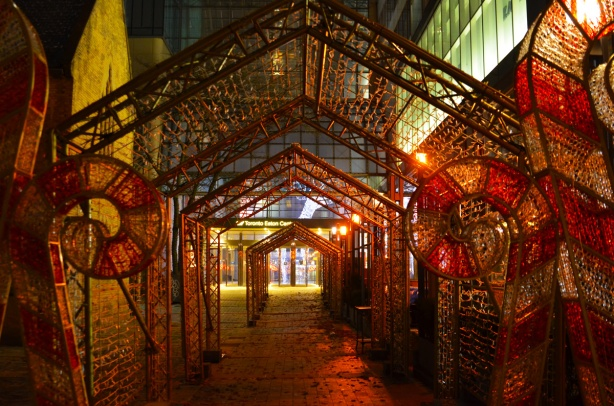 arches and big candy canes, frame for lights outside Eaton Centre, but lights not on.
