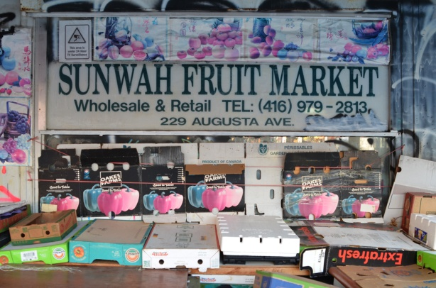 window of Sunwah fruit market in Kensington before the store opens, no food on display