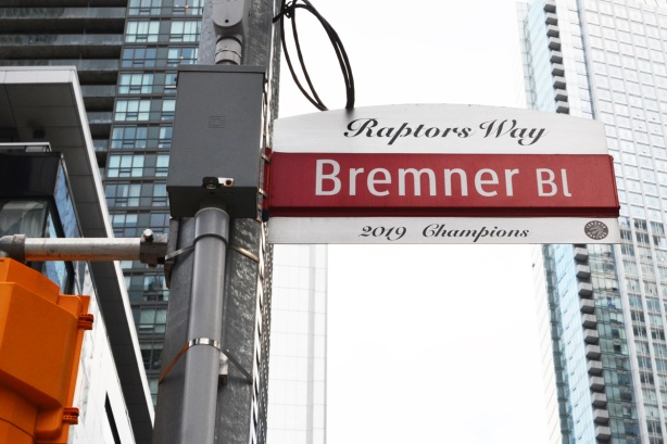 street sign for Brmener Bl that has been turned into Raptors way to celebrate their 2019 NBA championship. The sin is red and white inside of the usual blue and white