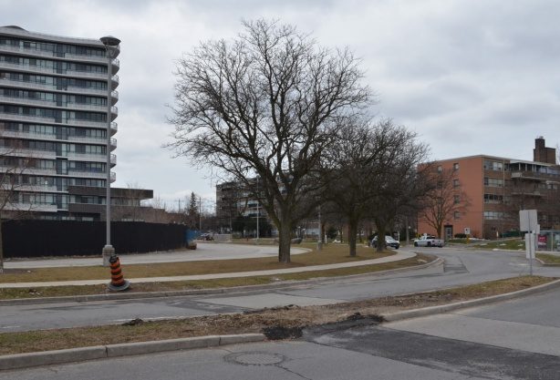 Donway West, older low rise apartments on the right, taller and newer condos on the left