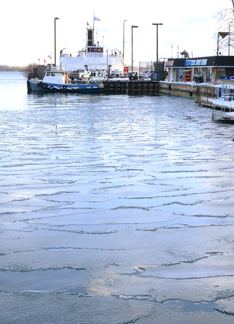 ice starting to form in harbour where the Toronto island ferry is docked