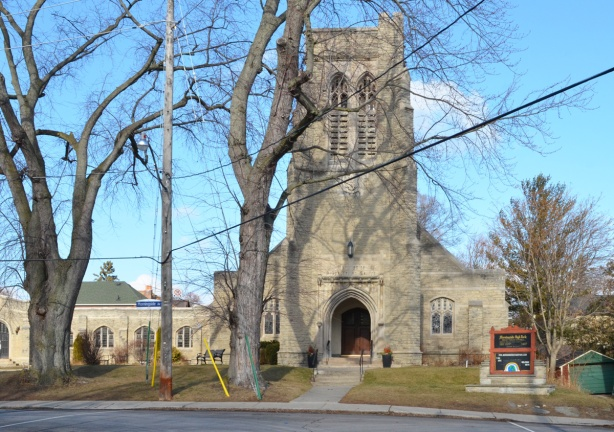 front entrance and steeple of Morningside High Park, a stone church built in the Gothic style in 1917