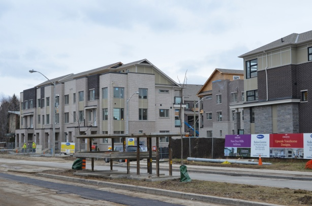 new grey townhouses being built on the Donway in Don Mills