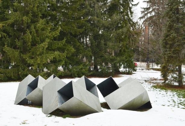 metal boxes with open ends, sculpture on the ground, with snow, Glendon campus, by Ray Spiers in 1975