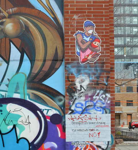 graffiti alley, urban ninja squadron paste up, t bonez in pink and red