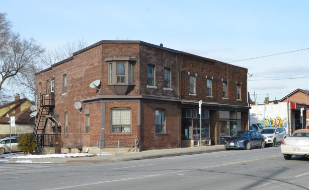 old two story brown brick building on Kingston Road