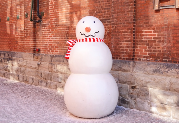 tall fake snowman with a red and white striped scarf, in the distillery district