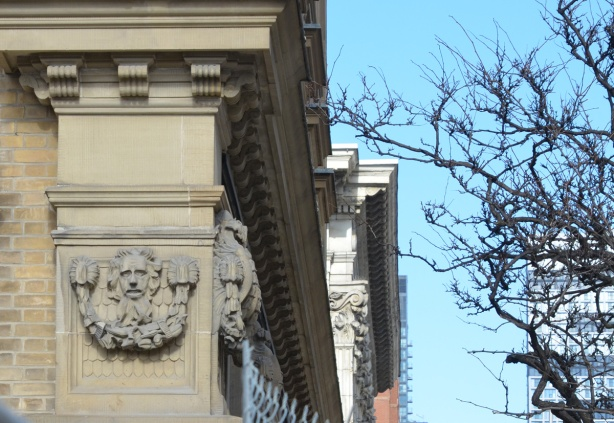 small relief sculpture high on a wall of the St. Lawrence Hall