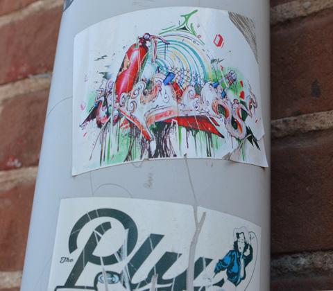 sticker graffiti on a pole