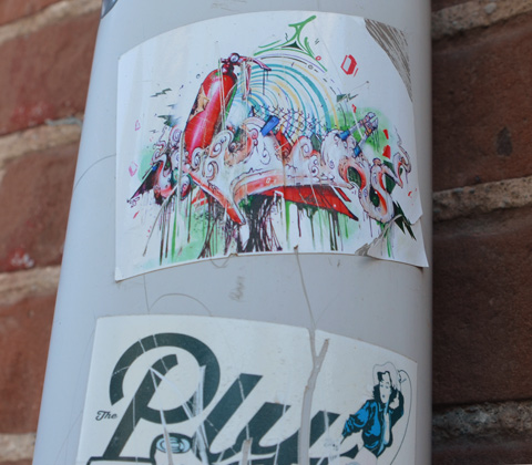 sticker graffiti on a pole