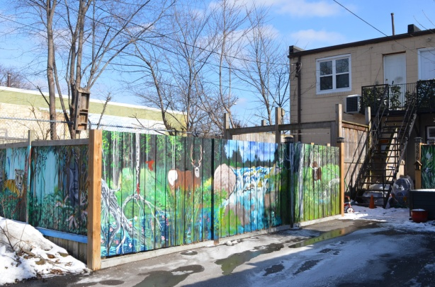 murals on a wood fence between two properties, in an alley, woodland animal theme, a deer, a moose,