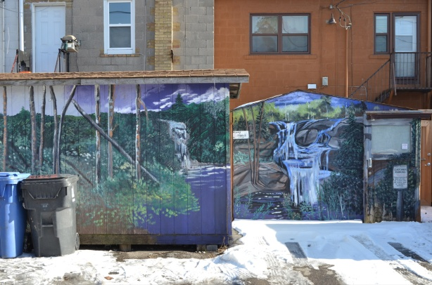 two murals in a lane, waterfall theme for both of them, the work of B C johnson