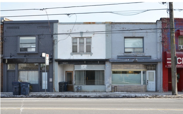 three empty storefronts at 1557, 1559 Kingston Road, two storey buildings in shades of grey