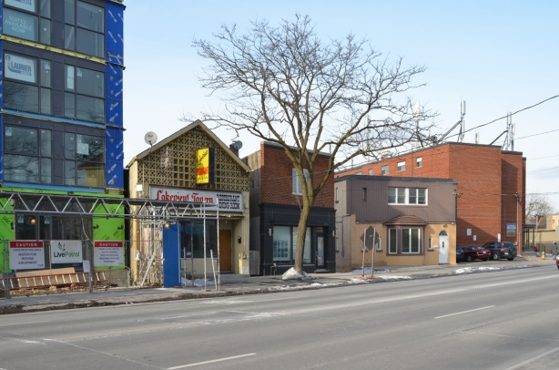 beside a new condo building, older smaller buildings on Kingston Road, Lakeview Tavern,