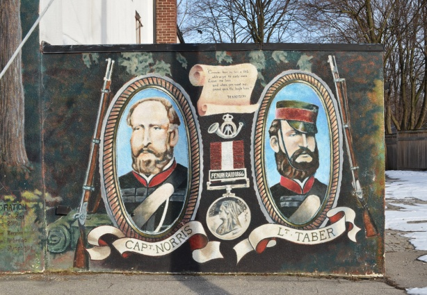 mural on side of Legion 13 building, two portraits in oval frames, Norris and Taber, Fenian Raids history