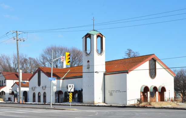 white church at Midland and Kingston Road, Saint Theresa Parish, Shrine of the Little flowers, red cermaic tile roof, arched doorways and windows