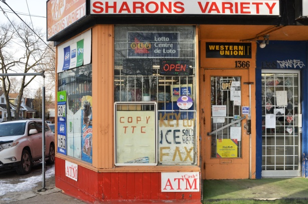 windows and entrance of Sharons Variety store on Kingston Road