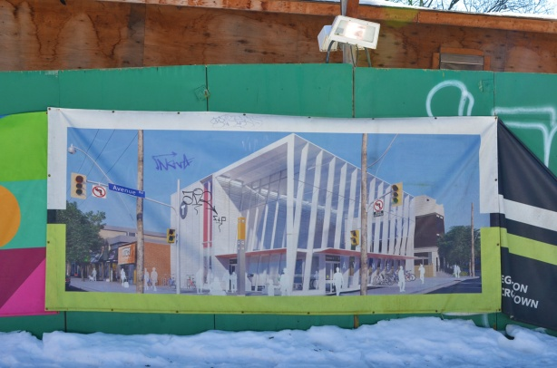 picture on green hoardings, an image of what Avenue Road subway station is going to look like when its finished
