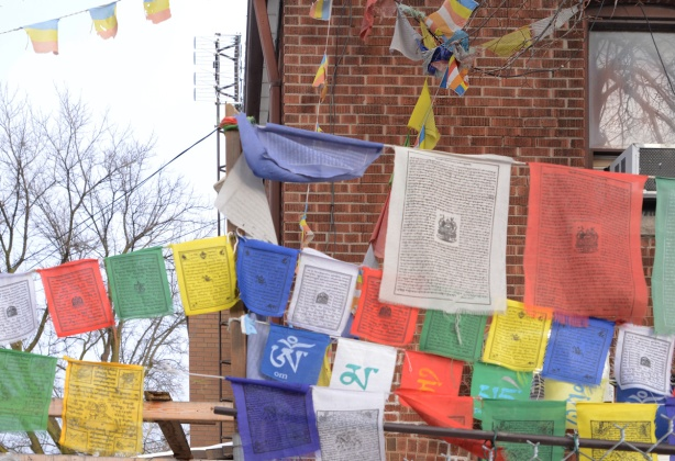 colourful Tibetan Buddhist prayer flags strung outside a store