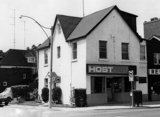 old black and white picture, 1981, of host rent a car shop at Imperial and Yonge, in Toronto, old two storey house