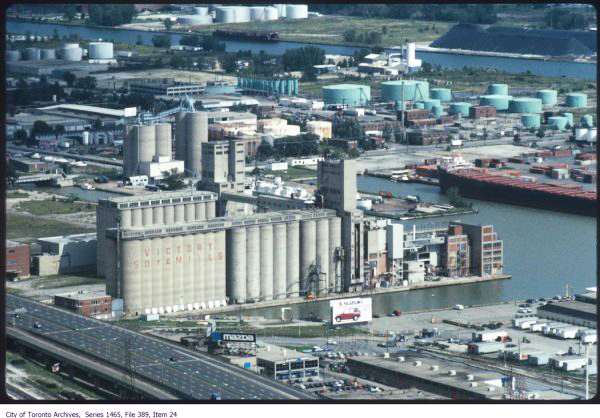 old colour photograph of Victory Soya Mills with Port Lands behind