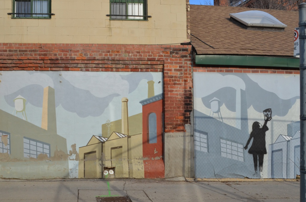 closer up view of murals in an alley