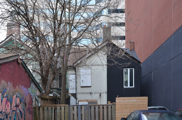 back of top part of rowhouses, seen from a lane