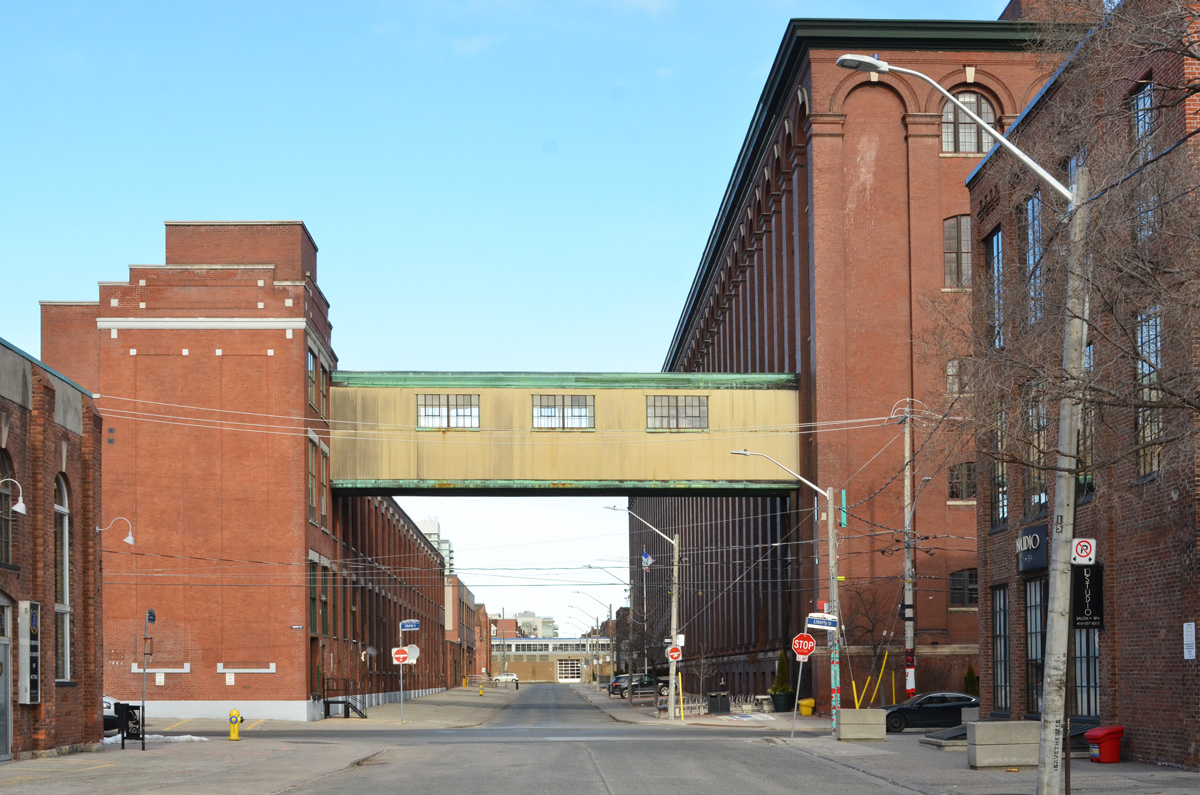 old factory buildings in Liberty Village, with a connecting bridge between them that is over the street