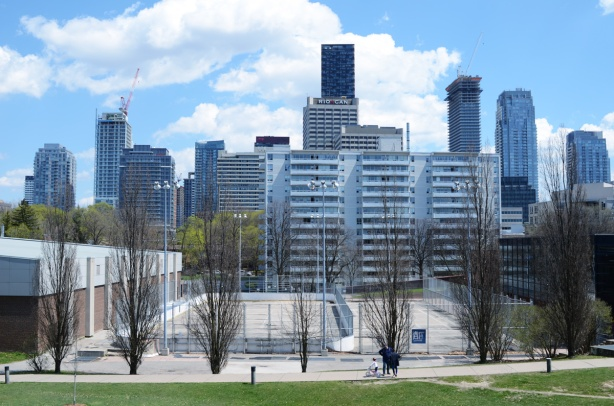 view of city skyline from Eglinton Park - looking east towards Yonge & Eglinton. Tennis courts in the foreground