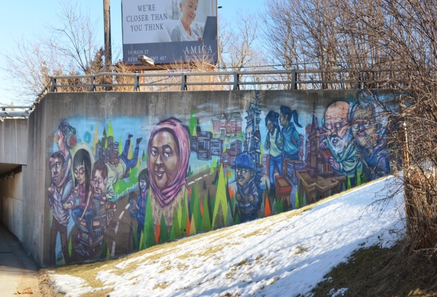 mural by elicser on the concrete wall of a C P R overpass in Scarborough