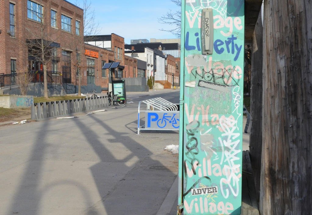 turquoise metal box with liberty village words on a street