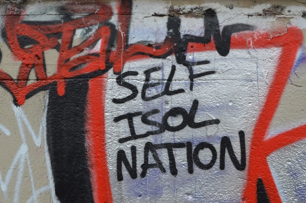 self isol nation spray painted on a wall as part of a graffiti painting