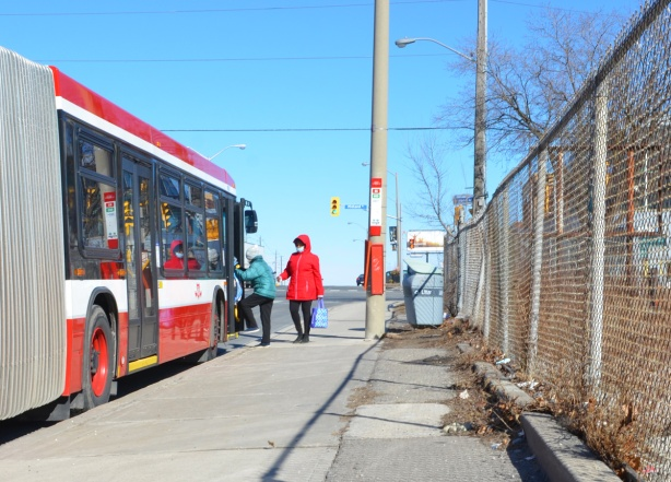 two women getting on a Sheppard TTC bus at Midland