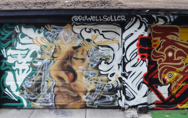 mural by rodwell soller, a mans face with eyes closed, calligraphy