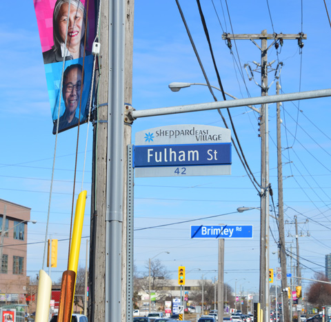 street signs and banners on utility poles, Sheppard East Village, Fulham Street, Brimley Road,