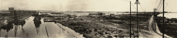 panorama - 1914 picture of building of Keating channel to divery mouth of Don River to Lake Ontario, black and white vintage photo, also Port Lands before they were developed