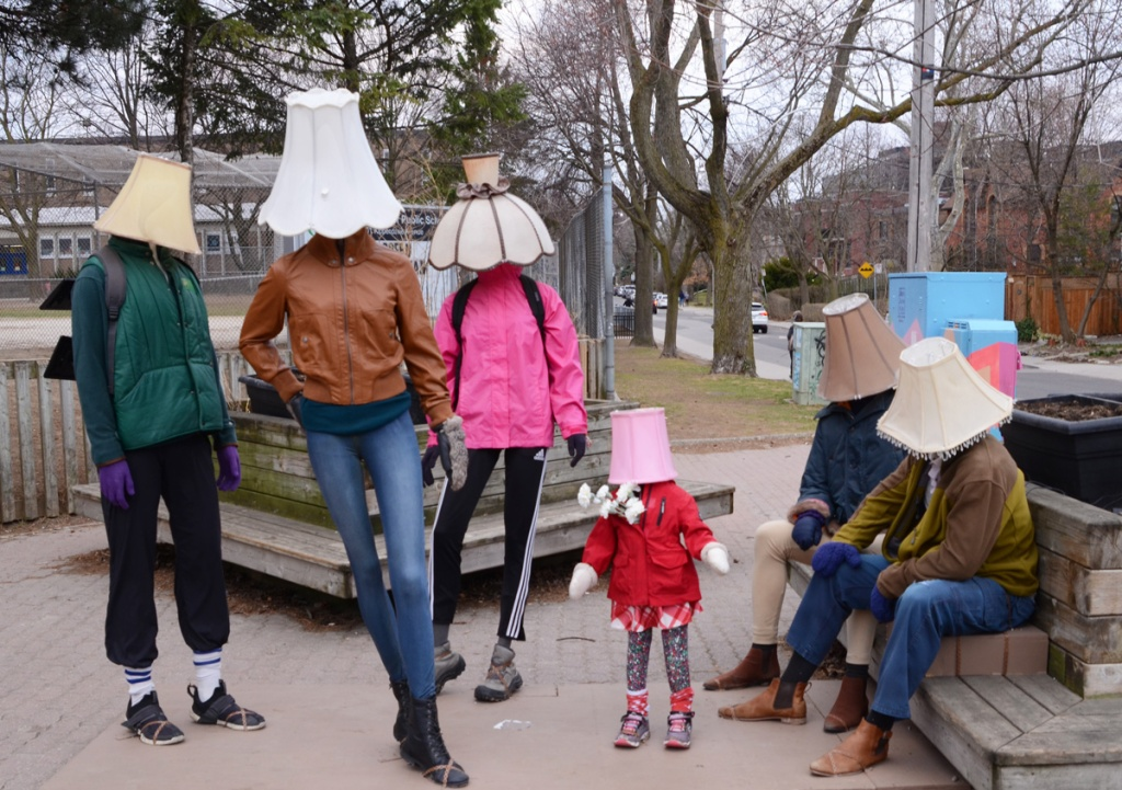 Luminosity public art installation of 6 mannequins with lampshades for heads