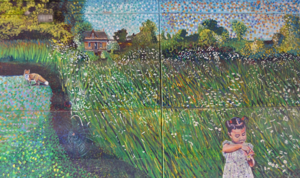 Part of a mural, outdoors summer rural scene with house in the distance, a fox by a creek and a girl in the foreground in a flowered dress and her hair in two pigtails, surrounded by a field of long grass and flowers