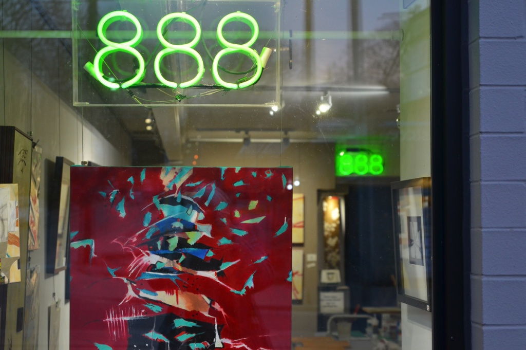 window of an art gallery at number 888, an abstract painting in the window predominantly red