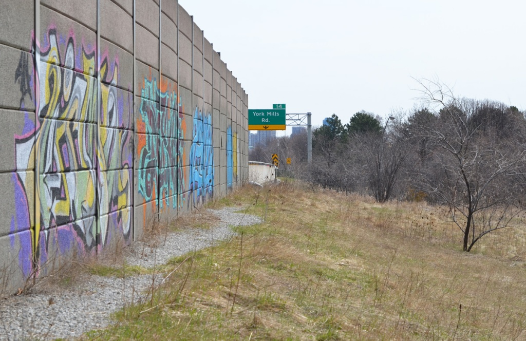 graffiti on a concrete wall beside the Don Valley Parkway just north of York Mills Road