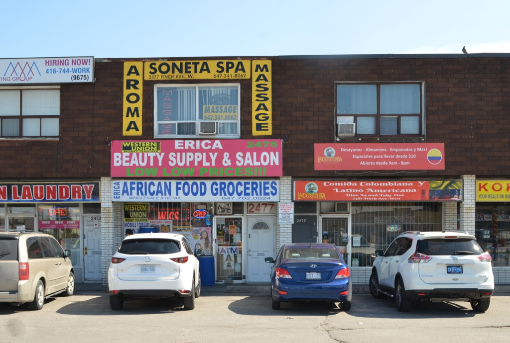 part of a strip mall on Finch West, laundry, African food groceries, Erica beauty salon, Comida Colombiana Latino Americana,