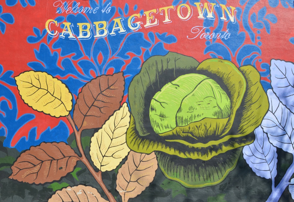 part of the Welcome to Cabbagetown mural, a head of green cabbage with some other leaves around it