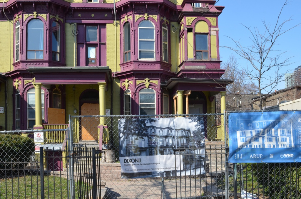 Dixon Hall, a series of rowhouses used as a rooming house is painted in purple and green.  it is boarded up and is about to be renovated