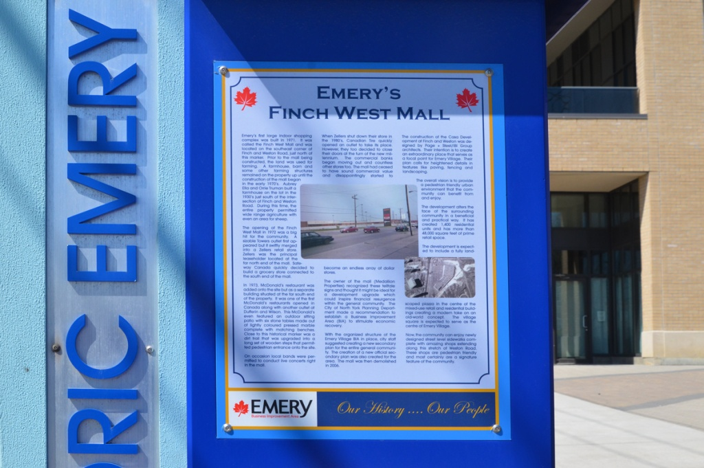 A plaque by a bus stop in Emery describing the history of the Finch West Mall