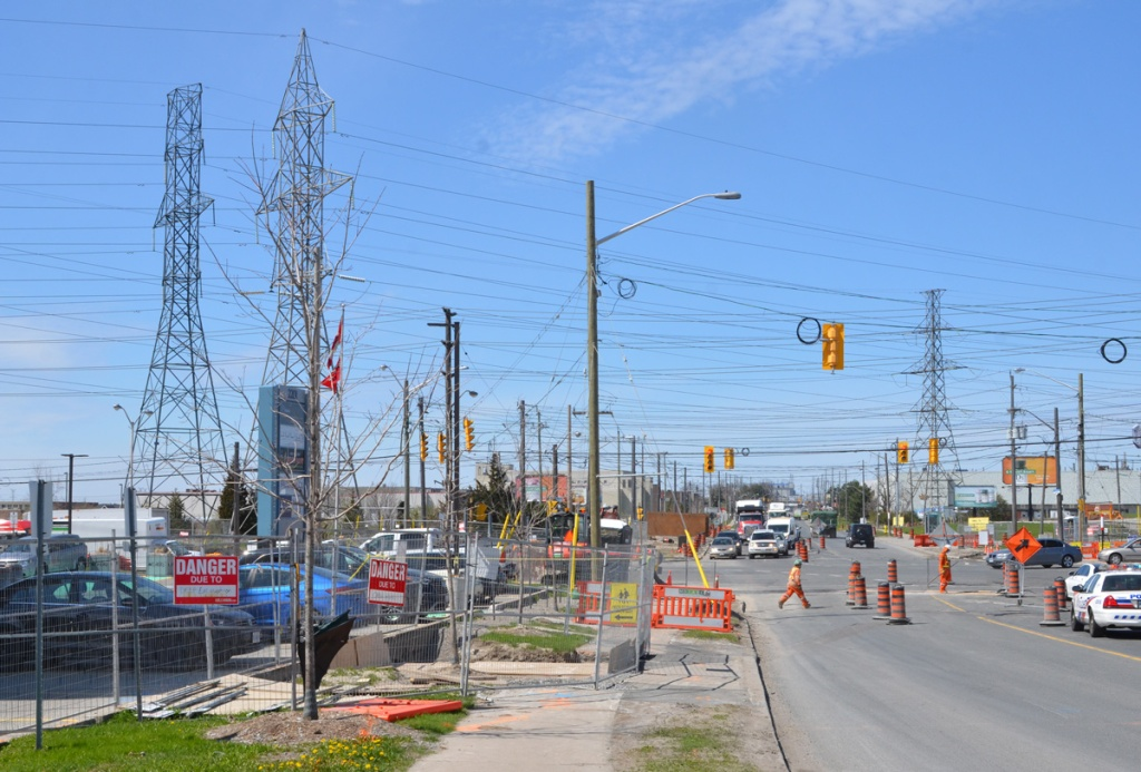 intersection of Finch and Weston Rd., looking west on Finch, construction, traffic, hydro poles,