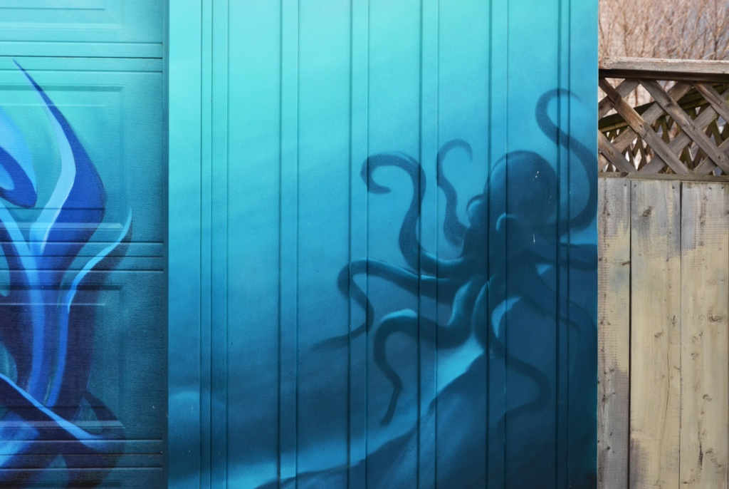 part of a mural, blue background with a darker blue octopus