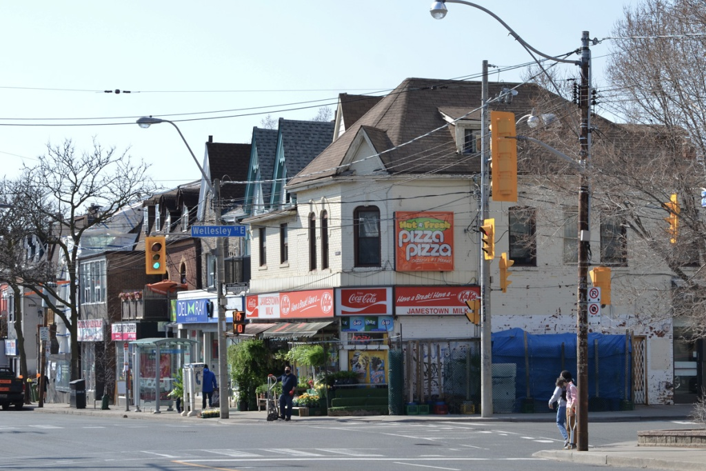 southwest corner of Parliament and Wellesley with Pizza Pizza ad on the corner above Jamestown Milk convenience store