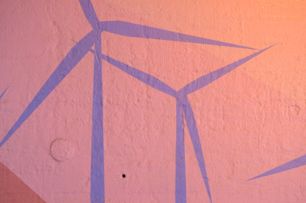 purple windmills on an orange pink background, part of a Ryan Smeeton mural on Carlaw