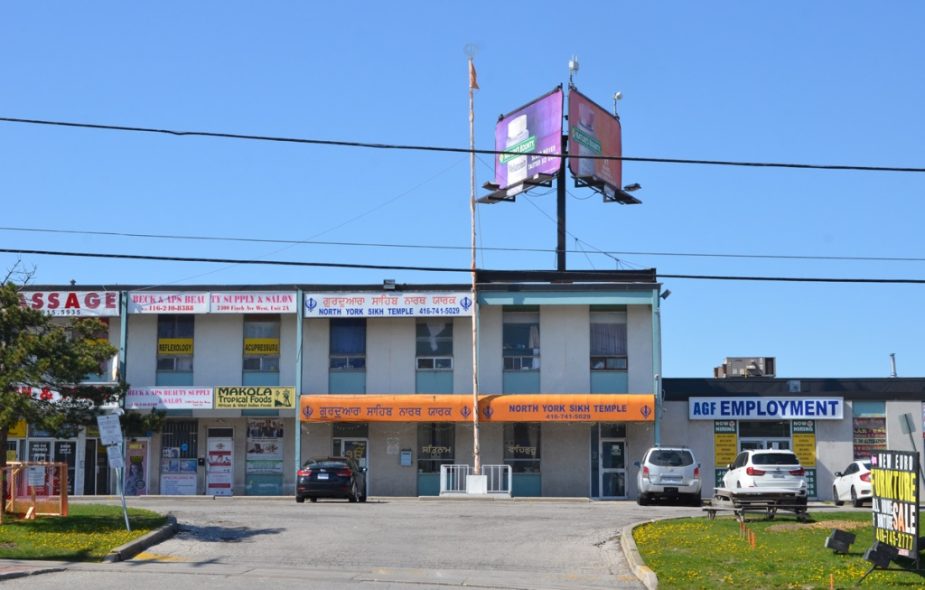 sikh temple in a two story plaza, beside Beck and Aps beauty supply and salon, and Makola Tropical foods, and employment agency