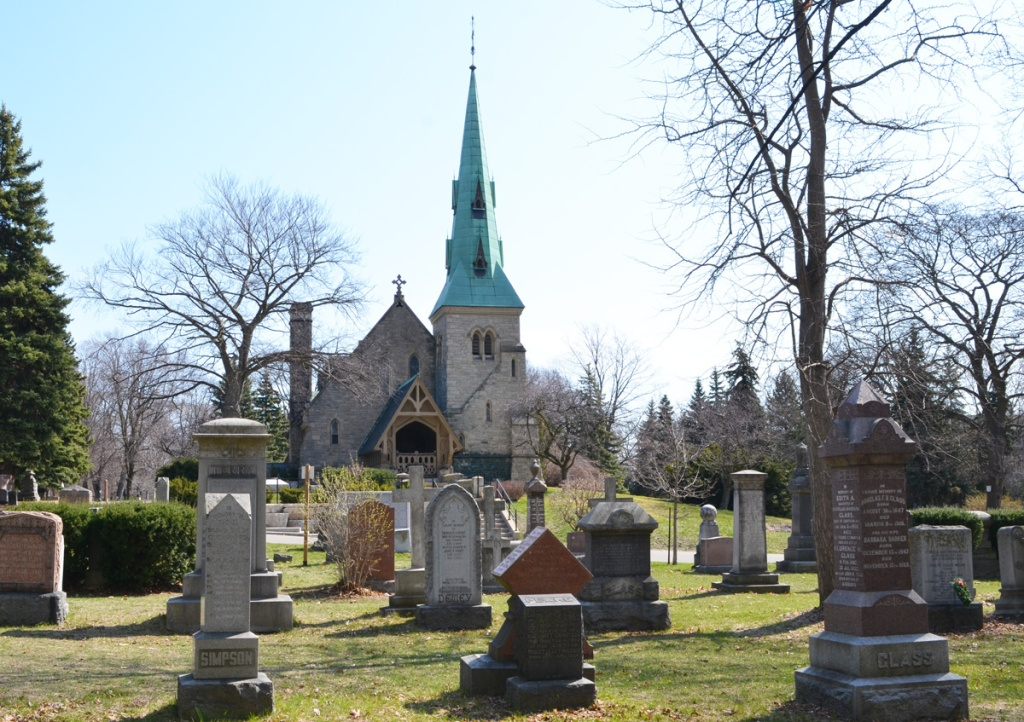 church building with copper green steeple on a small hill in a cemetery, St. James cemetery